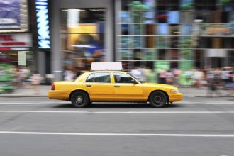 Panning shot of a New York city taxi cab at Times Square in New York, USA.