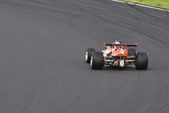 a race car taking a corner at Silverstone