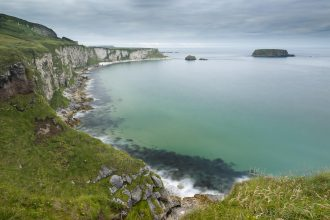 Scenic coastal view along pathway out to Carrick-a-rede rope bridge, Northern Ireland